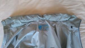 rolled away hood on waterproof jacket