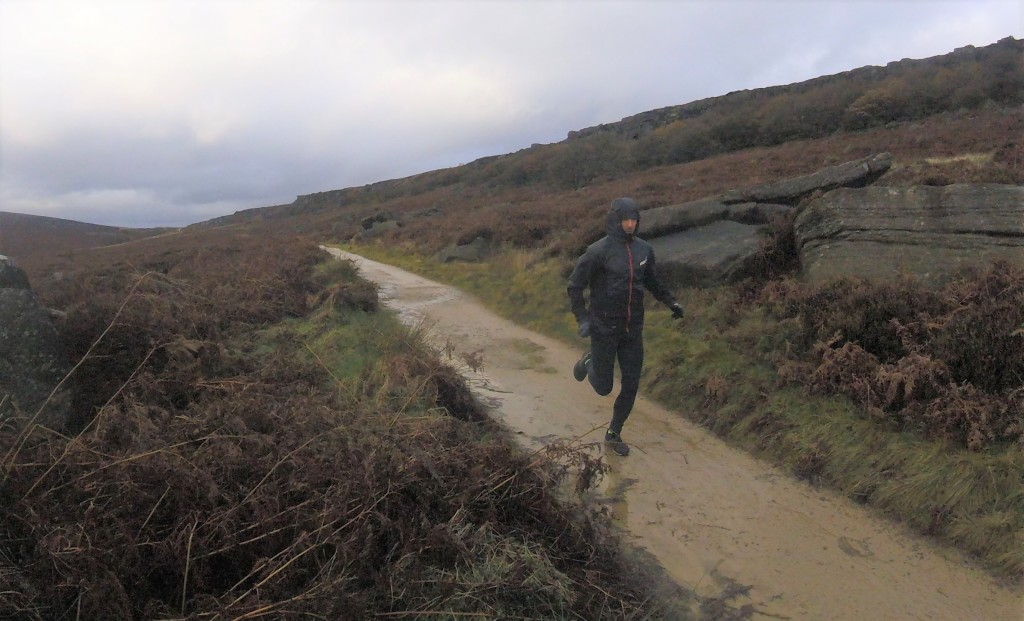 Runner wearing Inov-8 AT/C Softshell Pro FZ