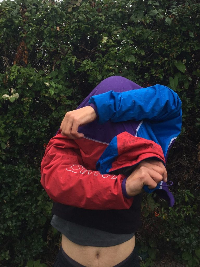 photo of taking off a smock