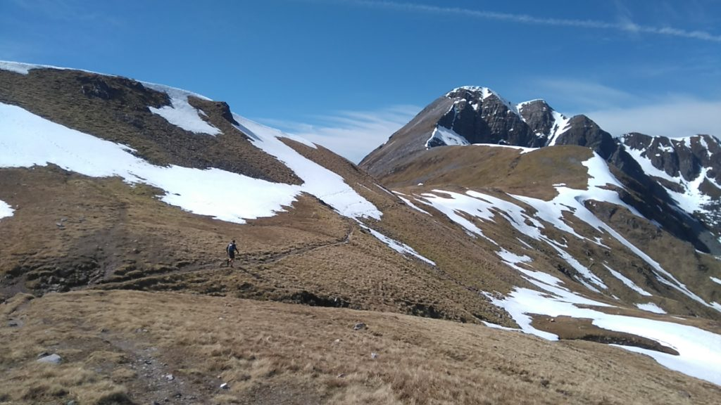 photo of runner in Scottish mountains
