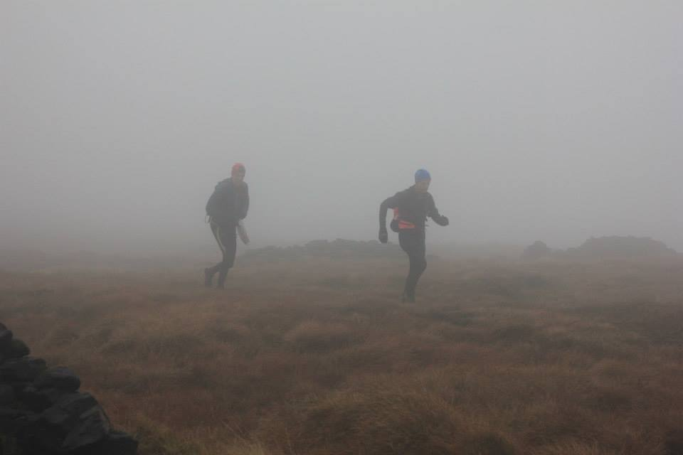 photo of runners in fog