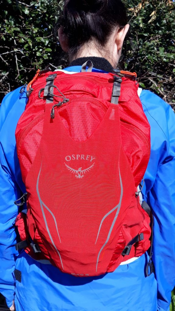 photo of girl wearing Osprey Duro 15