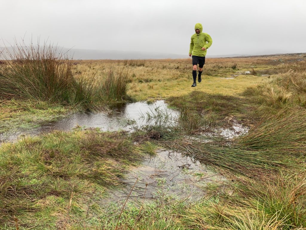 photograph of runner and puddles