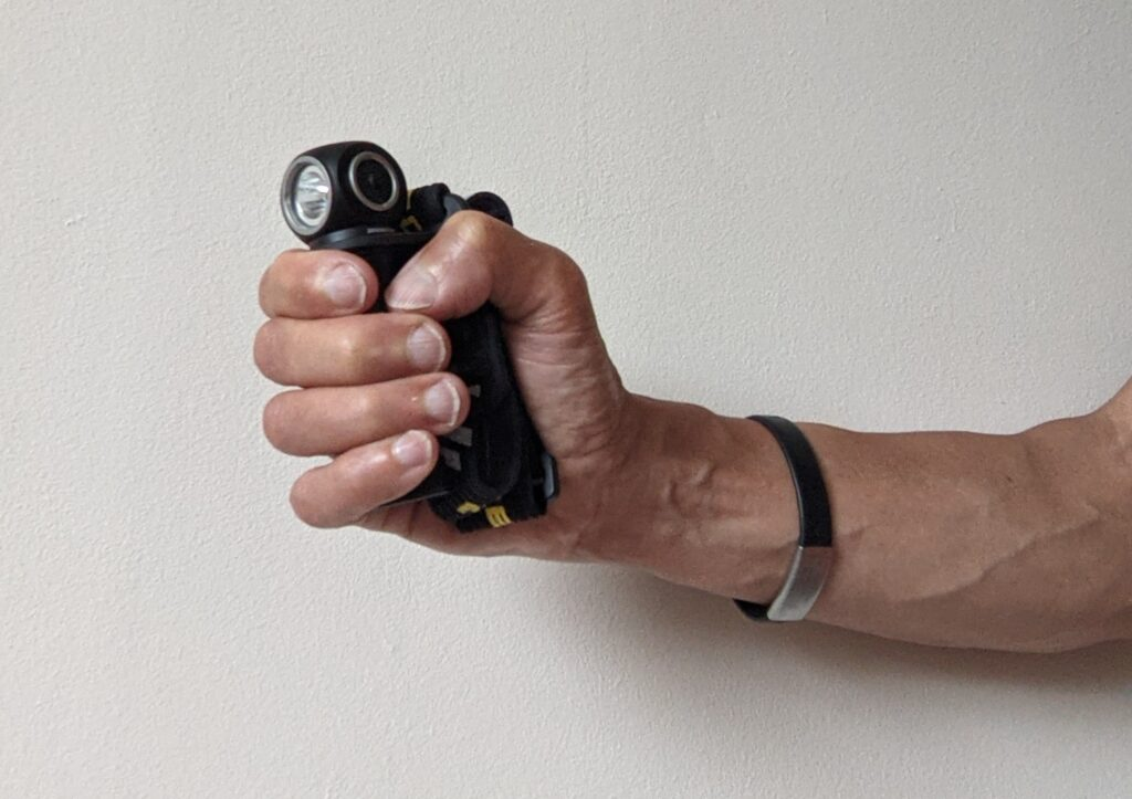 photo of person holding the Nitecore UT32 torch